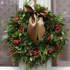 beautiful natural christmas wreath composed of green leaves and