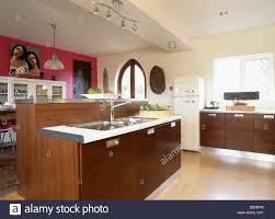 modern cream kitchens pink wall in large modern cream kitchen with dark wood units and