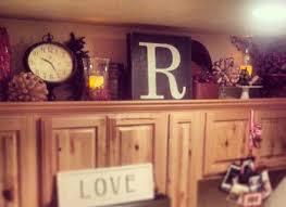 decorating above kitchen cabinets ideas decor ideas for above kitchen cabinets cabinetdirectories com