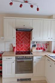 cream shaker country style kitchen red metro tile herringbone
