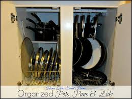 organized pots pans u0026 lids with tension rod shower hooks u0026 dish