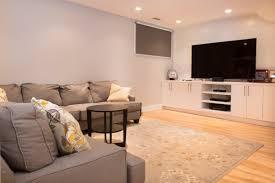 basement renovation with modern builtin media console with backdrop calgary alberta 4x jpg