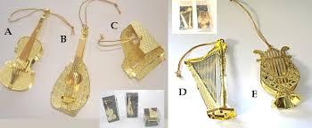 ornaments in brass violin harp lute lyre or piano