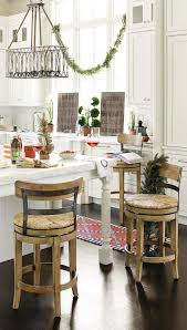 kitchen decorating ideas how to decorate we love the way this kitchen was decorated for the holidays with swags of greenery and even a red rug