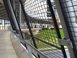 the woven wire mesh fence panels for this pedestrian bridge create
