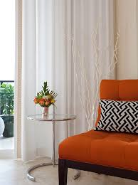 Orange Sofa Chair Orange And Black Interiors Living Rooms Bedrooms And Kitchens