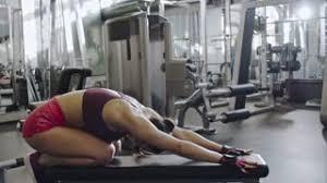 Leg Lift Bench Woman Doing Leg Lifts In A Gym Stock Video Footage Videoblocks