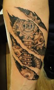 mechanical tattoo w ripped skin