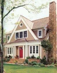 love the copper roof wide trim siding and paint color