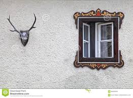 bavarian rural window with typical painted frame decorations stock