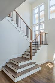 open entry with white oak hardwood flooring and hardwood stair