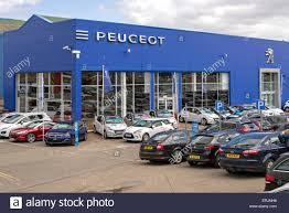 peugeot cars uk peugeot dealer at seafield in edinburgh scotland uk stock photo