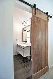 Barn Door Bathroom Privacy by Modern Industrial Bathroom With Organic Elements In Center City