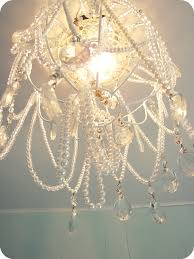 Wire Chandelier Diy Diy Chandelier Made From A Dollar Store Hanging Basket And Thrift