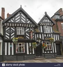 old english tudor building pub and sign the green dragon in