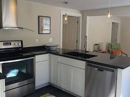 portland maine customer plans to use cliqstudios again portland maine kitchen has classic white shaker cabinets in peninsula design with black granite countertops