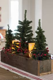small faux trees and pillar battery candles wrapped with