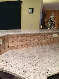 blanco gabrielle granite with travertine tile backsplash kitchen