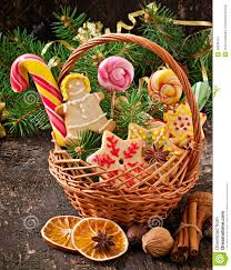 christmas gingerbread cookies and lollipops in a basket stock