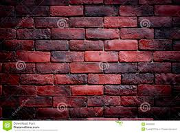 weather texture of stained old dark brown and red bricks wall