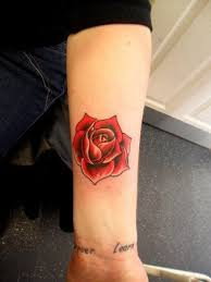 beautiful feminine single red rose arm tattoo design for women