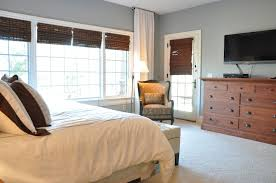 love the bamboo shades with white window trim against the blue