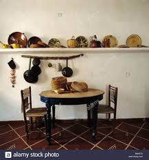 circular dining room circular table and old wooden chairs in kitchen dining room with