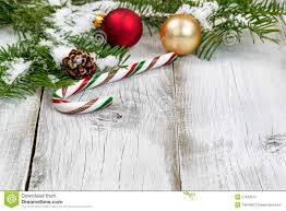 candy cane with snow covered fir branches and ornaments stock