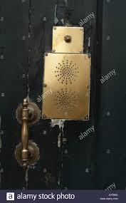decorative brass door knocker and buzzer stock photo royalty free