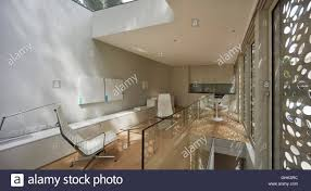 open plan living with window wall and screen house in brixton