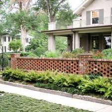 Beautiful Brick Fence With Potted Plants On Top And Awesome - Brick wall fence designs