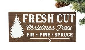 wood fresh cut tree sign handmade by honeysuckle and pine