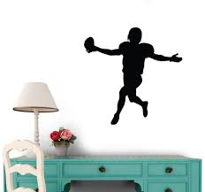 amazon com football silhouette wall decal by wallmonkeys peel and amazon com football silhouette wall decal by wallmonkeys peel and stick graphic 18 in w x 18 in h wm79230 home kitchen