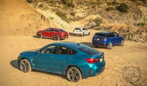 porsche cayenne or range rover sport car wars suv edition bmw x6m vs mercedes amg gle63 s