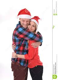 christmas young beautiful couple in santa hats in love smiling