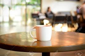 coffee cup on the table in coffee shop blur background stock photo