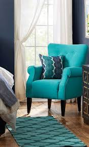 perfect teal chair with geometric rug for cute living room ideas