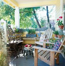 Patio Warehouse Sun Prairie Wi by Adirondack Chairs And A Cast Iron Seat Are Nestled Amidst Potted Plants On The Ample Front Porch Jpg