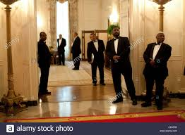 white house butlers watch as president obama makes his way towards