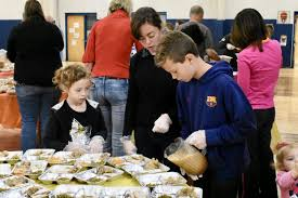 st katherine s parishioners reach out with family volunteer day