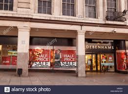 half price restaurant half price sale posters in debenhams window on boxing day in stock