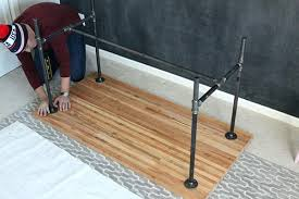 Diy Work Desk Pipe Leg Desk Straightening The Legs Of A Diy Work Table Steel