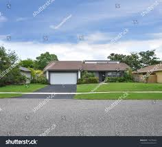 ranch style home suburban ranch style home blacktop driveway stock photo 115276423