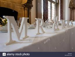 Mr And Mrs Sign For Wedding Mr And Mrs Sign On Wedding Reception Head Table Stock Photo