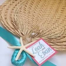 raffia fans these palm leaf fans are great for wedding favors ceremony
