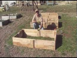 Building Raised Beds Building Raised Beds From Reclaimed Pallet Wood Youtube