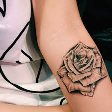 black and white rose tattoo on left forearm black and white rose
