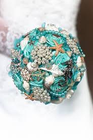 seashell bouquet aqua starfish brooch bouquet wedding theme seashell bouquet