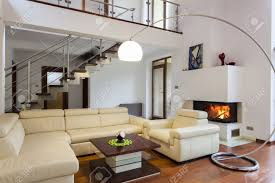 big and comfortable living room with bright sofa stock photo
