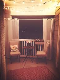 Ideas On Decorating A Studio Apartment Small Apartment Patio With Lights Strung At Night Favorite